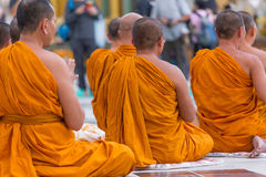 Buddhist monks pray at Shwedagon Pagoda in Yangon, Myanmar Royalty Free Stock Images