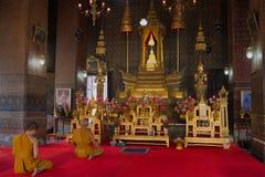 Buddhist monks pray in vihane Wat Thepthidaram Worawihan. Bangkok Royalty Free Stock Image