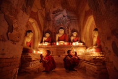 Buddhist monks at prayer Stock Photos
