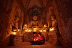Buddhist monks at prayer. A Buddhist monks at prayer Stock Image