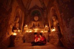 Buddhist monks at prayer Stock Image