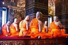 Buddhist monks. During prayer in the temple of Thailand Royalty Free Stock Photography