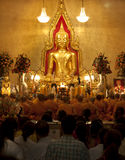 Buddhist monks praying stock images