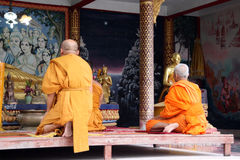 Buddhist monks praying Stock Photo