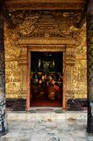 Buddhist monks praying during an afternoon ceremony at their wat stock photos