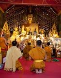 Buddhist monks praying on eve Royalty Free Stock Photo