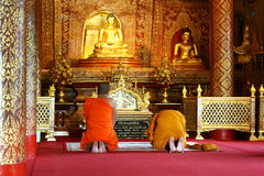 Buddhist monks praying in a temple, Thailand Royalty Free Stock Photography
