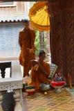 Buddhist monks prepare offerings Stock Image