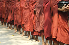 Buddhist monks in procession Royalty Free Stock Image
