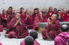 Buddhist monks put their palms together and chanting after drastic debating , Sera monastery , Tibet. Buddhist monks put their palms together and chanting , for stock image