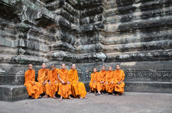 Buddhist monks in reddish yellow robes Stock Images