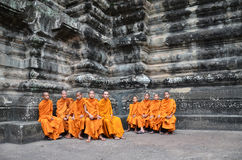 Buddhist monks in reddish yellow robes Royalty Free Stock Photo