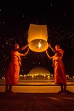Buddhist monks release sky lantern to worship Buddha's relics. CHIANGMAI, THAILAND - NOV 16: Buddhist monks release sky lantern to worship Buddha's relics during Stock Image