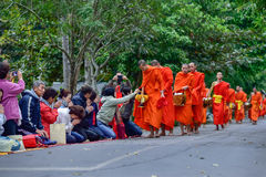 Buddhist monks daily ritual of collecting alms and offerings Royalty Free Stock Photography