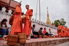 Buddhist monks daily ritual of collecting alms and offerings Royalty Free Stock Images