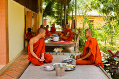 Buddhist monks of a riverside temple in Kampot, Cambodia Stock Photos
