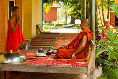Buddhist monks of a riverside temple in Kampot, Cambodia Royalty Free Stock Image
