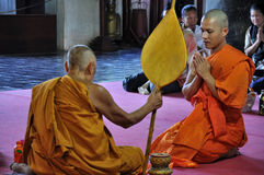 Buddhist Monks sat with folded palms Royalty Free Stock Images