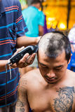 Buddhist monks shave their hair to be ordained Royalty Free Stock Photography