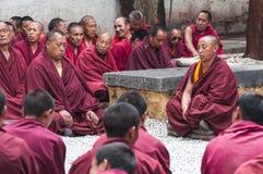 Buddhist monks sitting on the ground and chanting , Sera monastery , Tibet royalty free stock image