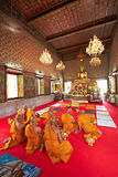 Buddhist monks sitting in temple Royalty Free Stock Photo