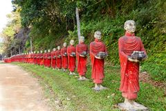 Buddhist monks statues row Royalty Free Stock Photography