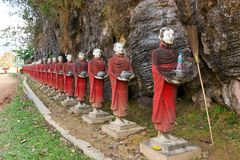 Buddhist monks statues row Royalty Free Stock Image