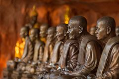 Buddhist monks statues symbol of peace and serenity at Wat Phu Tok temple, Thailand, asceticism and meditation, buddhist art work Stock Image