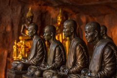 Buddhist monks statues symbol of peace and serenity at Wat Phu Tok temple, Thailand, asceticism and meditation, buddhist art work Royalty Free Stock Photo