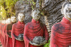 Buddhist monks stone statues row at Kaw Ka Thaung cave. Hpa-an, Myanmar Stock Photo