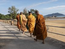 Buddhist monks stroll royalty free stock images