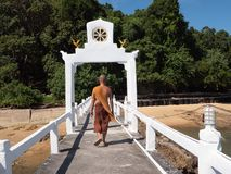 Buddhist monks stroll stock images