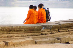 Buddhist monks talk with western friend Stock Images