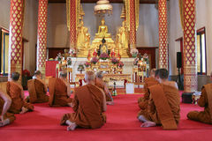 Buddhist monks in temple. Monks seated inside temple. Bangkok Thailand Royalty Free Stock Photo