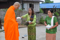 Buddhist monks in Thailand. Buddhist monks tradition, every morning people are make preparation to offer the food to the monk, Kanchanaburi, Thailand on November Stock Photo