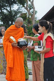 Buddhist monks in Thailand. Buddhist monks tradition, every morning people are make preparation to offer the food to the monk, Kanchanaburi, Thailand on November Royalty Free Stock Image
