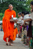 Buddhist monks at their morning almsround Royalty Free Stock Photo