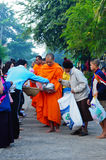 Buddhist monks tradition. People are make preparation to offer the food to the monk, Kanchanaburi, Thailand on November 6, 2010 Royalty Free Stock Images
