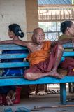 Buddhist monks at train station of Bago stock photo
