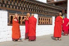 Buddhist monks at the Trashi Chhoe Dzong, Thimphu, Bhutan Royalty Free Stock Photo