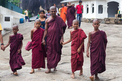 Buddhist monks visiting Dambulla cave temple Stock Photos