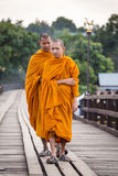Buddhist monks walk on Bamboo Bridge the Sangkhlaburi River Royalty Free Stock Photos