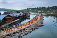 Buddhist monks walk on Bamboo Bridge Royalty Free Stock Photo