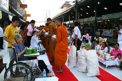 Buddhist monks walk collecting alms, Thailand. Stock Photo