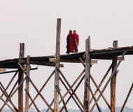 Buddhist monks walking on the bridge in Myanmar. Buddhist monks walking on the Ubein bridge in Mandalay, Myanmar Stock Photo