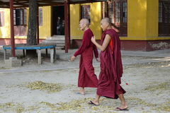 Buddhist monks walking at the pagoda Stock Photography