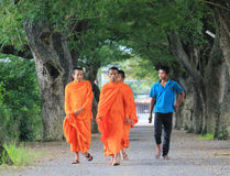 Buddhist monks walking on rural road in Dong nai, Vietnam.  Royalty Free Stock Image