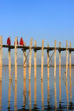 Buddhist monks walking on U Bein bridge, Amarapura, Myanmar Stock Photos
