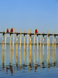 Buddhist monks walking on U Bein bridge, Amarapura, Myanmar Stock Images