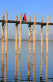 Buddhist monks walking on U Bein bridge, Amarapura, Myanmar Stock Photo